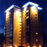 Picture of refurbished multi storey flats lit up at night.