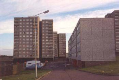Picture of multi storey flats before refurbishment.